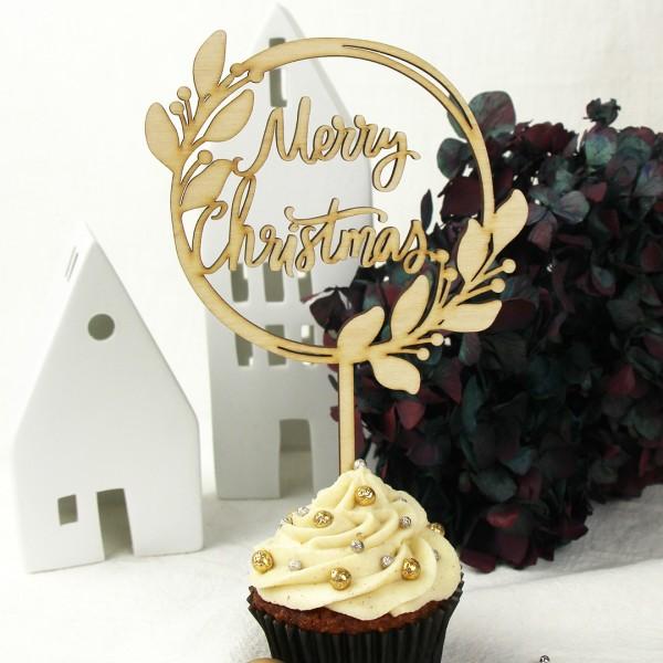 Cake Topper Merry Christmas auf einem weihnachtlich dekorierten Muffin