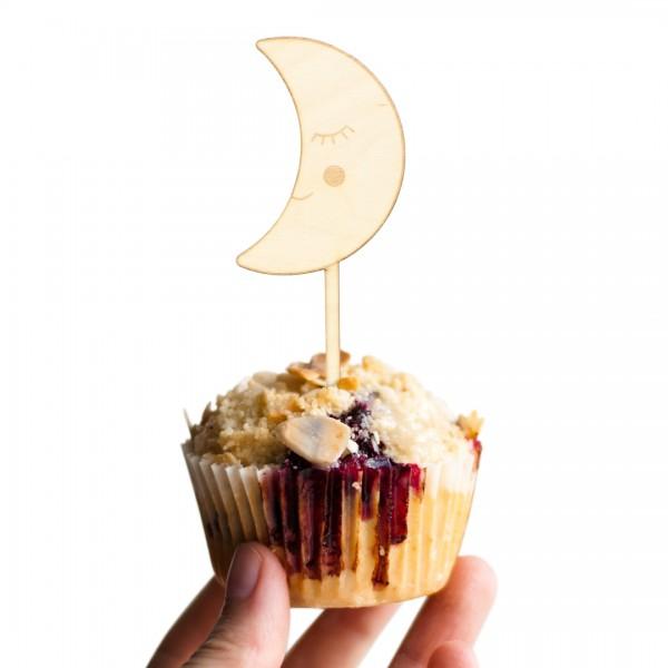 Süßer Mond Cake Topper mit Gesicht auf einem Muffin