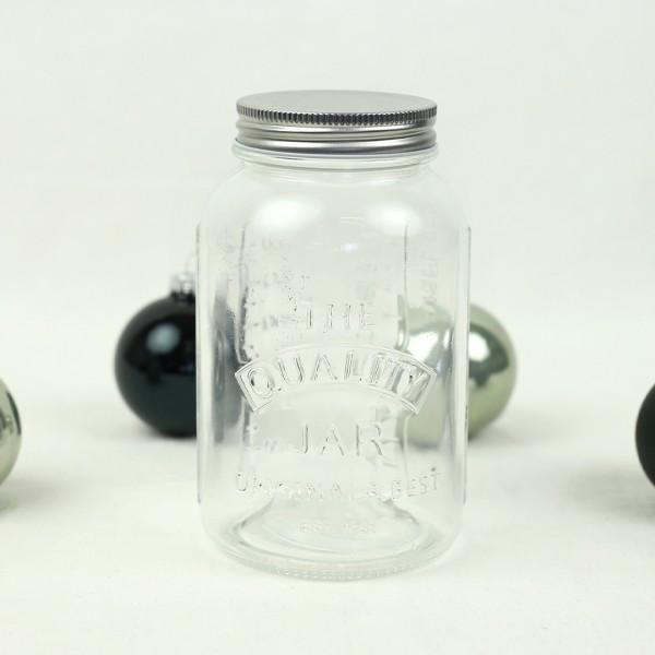 Leeres Glas mit Blechdeckel von vorne