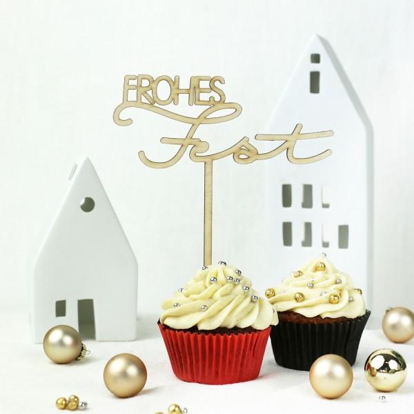 Frohes Fest-Cake Topper auf Muffin vor Weihnachtsdeko