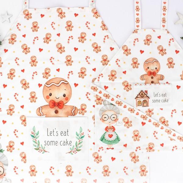 Mama und Kind Schürze Weihnachtsbäckerei mit süßen Lebkuchenfiguren und Zuckerstangen
