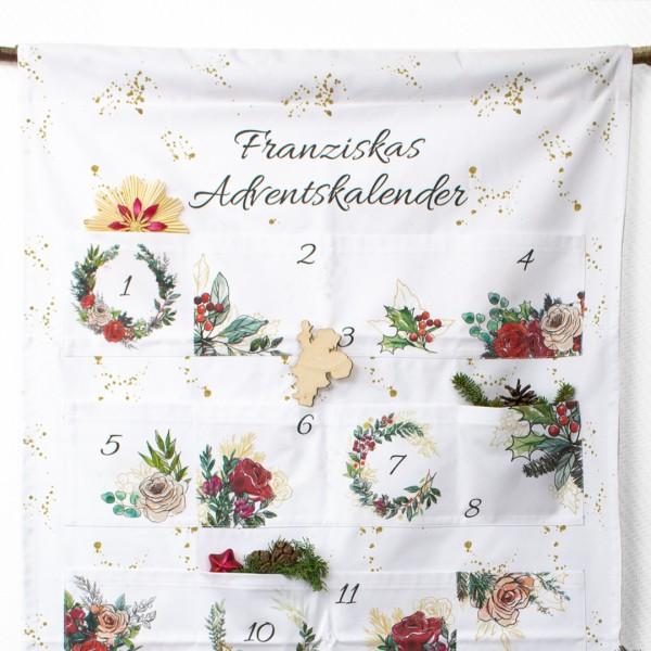 """Detailaufnahme Adventskalender """"Christmas Flowers"""" mit wunderschönen floralen Motiven und unseren weihnachtlichen Cake Toppern"""